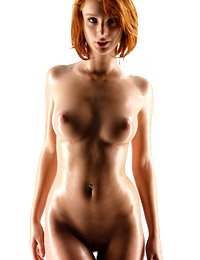 Oiled redhead clelia in the studio