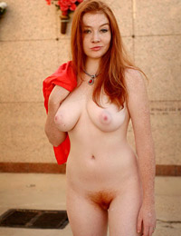 Naked redhead babe in strange places