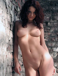 Nude babe in abandoned place
