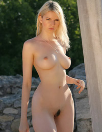 Naked babe in front of artifacts