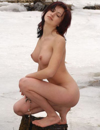 Hot naked babe on the snow