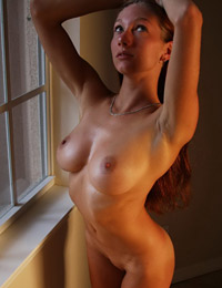Adorable redhead babe with nice boobs